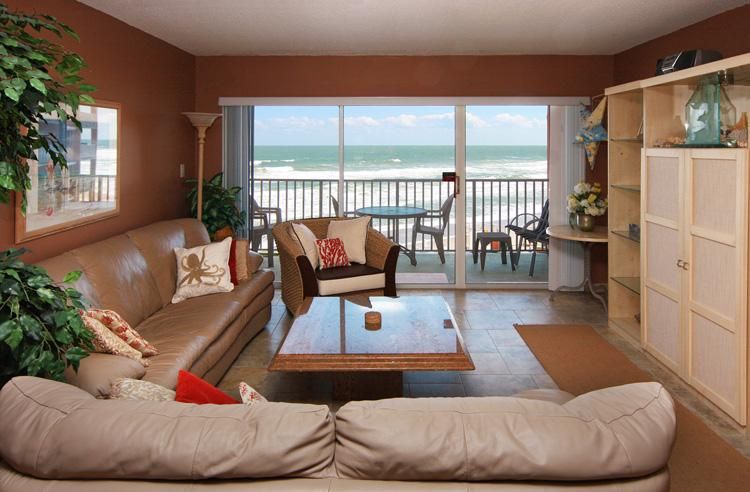 Living room with oceanfront views - Oceanfront - Renovated - Excellent Ocean Views - Satellite Beach - rentals