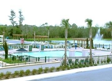 View from our house next to pool clubhouse & lake - The Villas at Seven dwarfs Lane - Former modelhome - Kissimmee - rentals