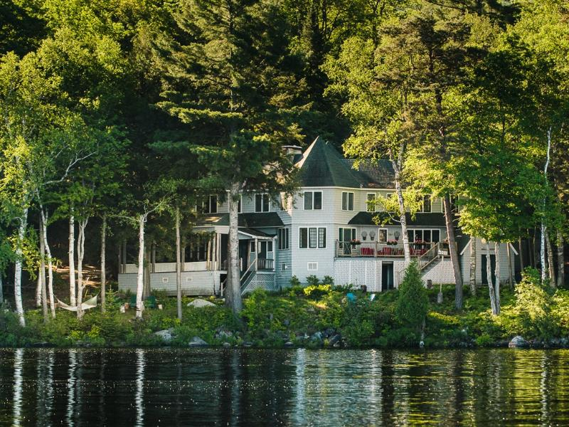 Camp To-No-Na water view - Camp To-No-Na fall issue of Adirondack Life Homes - Saranac Lake - rentals