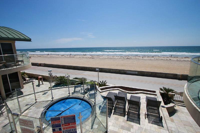 Patio and hot tub overlooking the boardwalk - Surf Rider Ocean Front Condo with Hot Tub - Pacific Beach - rentals