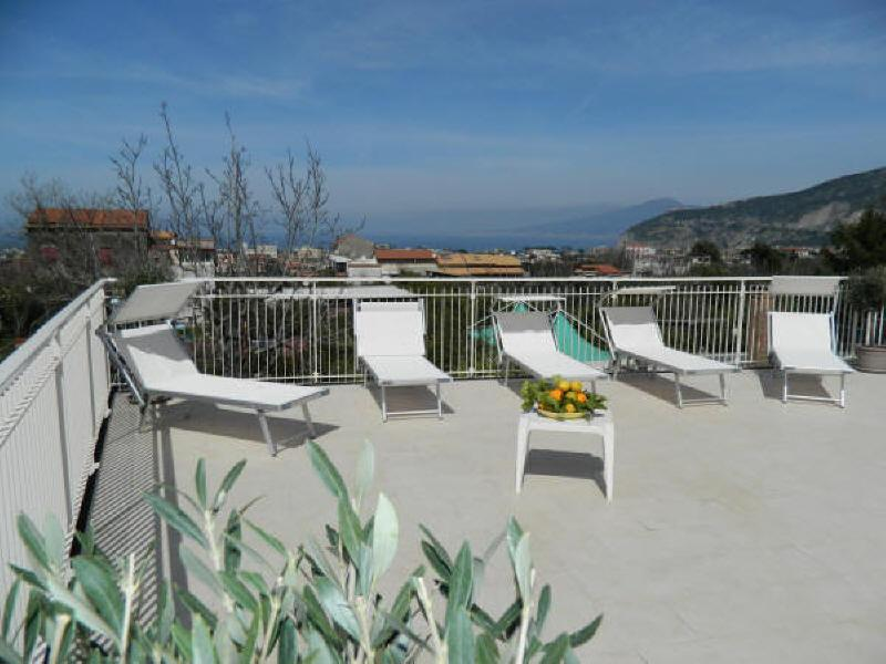 Exclusive Terrace Solarium equipped with sun beds, sun chairs, shower, tables, chairs, and barbecue - La Terrazza Vacation Rental - Sorrento - Sorrento - rentals