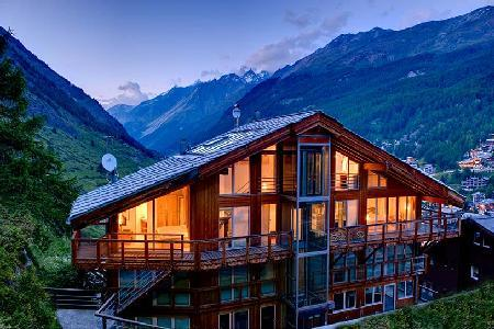 Architect-designed chalet Heinz Julen Penthouse with glass ceilings, hot tub & mountain views - Image 1 - Zermatt - rentals