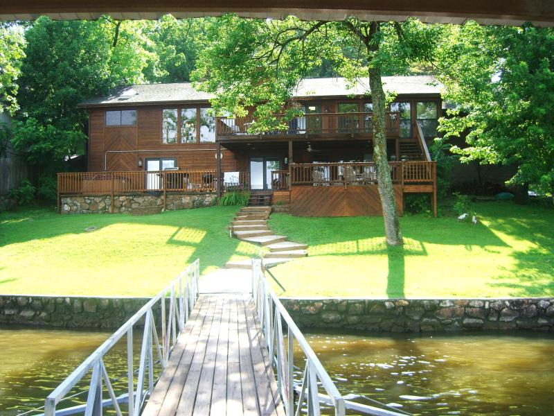 Lakeside view of Harmony from the dock - Harmony 3400 Sq Ft, 5BR, 6BA Lakefront w/ Hot Tub - Lake of the Ozarks - rentals