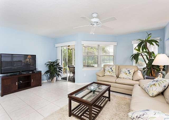 Enjoy the huge HDTV and leather sofas in the living room - Gulf & Bay Club: Bayside, 2 Bedrooms, Ground Floor - Siesta Key - rentals