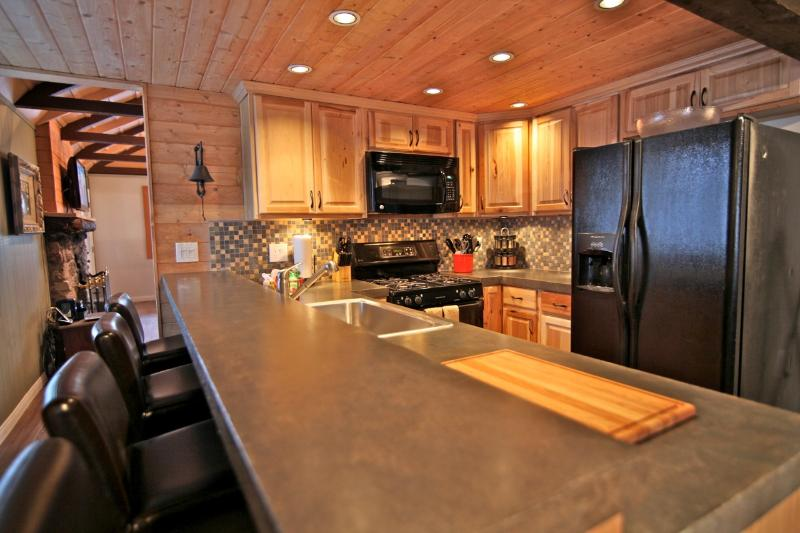 Gourmet kitchen with polished concrete counter tops - Alpine Grand Lodge - Classic Mountain Lodge - Lake Arrowhead - rentals