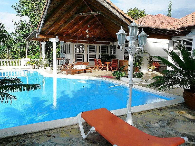 View over the pool to the covered terrace next to the apartment - Cosy 1BR apartment - Quiet & beautiful location - Sosua - rentals