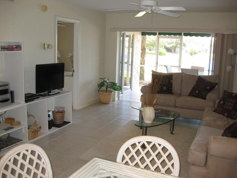 Living room - LAKEFRONT CONDO WALK TO VANDERBILT BEACH - IDEAL! - Naples - rentals