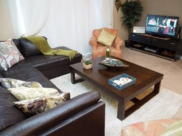 Living room with leather sectional and sofa bed - Elegant Townhome At Vista Cay Resort - Orlando - rentals