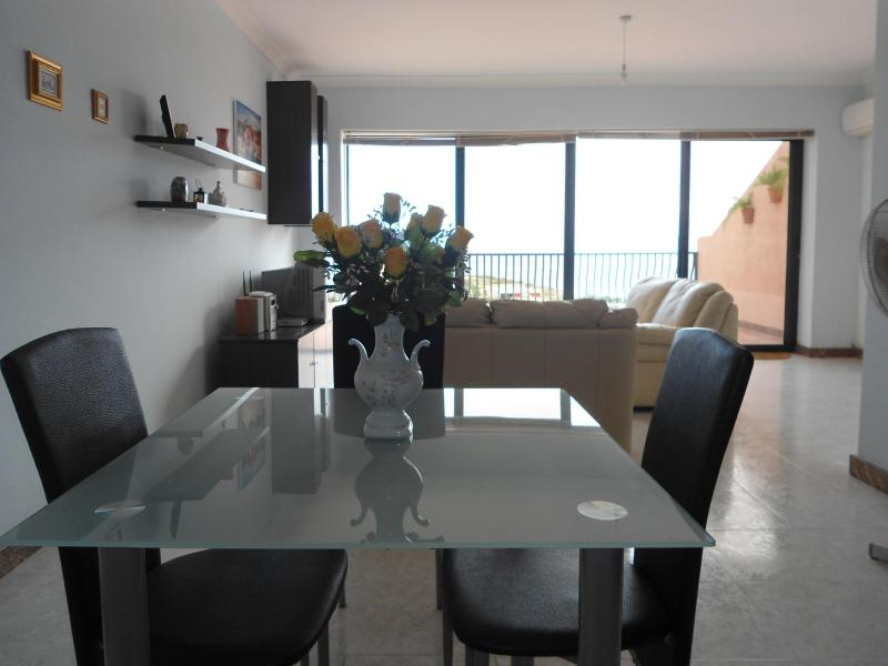 Dinning / Living area that leads you onto terrace with breathtaking sea ans country views. - Precious Penthouse with terrace enjoying sea and country views. - Pembroke - rentals
