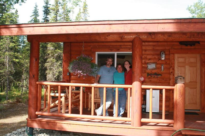 our family enjoying the front porch - Fishon cabin rentals - Sterling - rentals