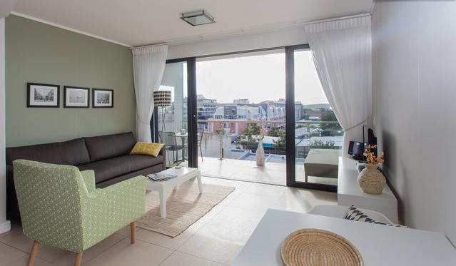 The living area flows onto the balcony - Fabulous 1-Bedroom De Waterkant Apartment - Cape Town - rentals
