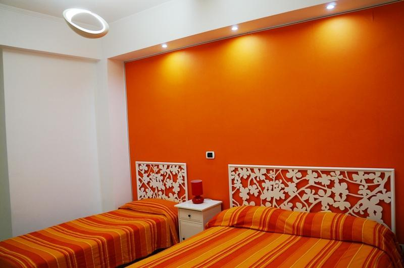 Orange bedroom - Colorful apartment 3 mins walk to stunning beach! - Terracina - rentals