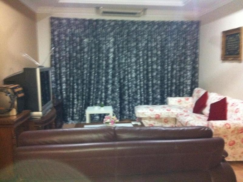 2 full sofa's, TV, stereo, air con & fan. Just perfect for your relaxation after a full day outing - 1 Borneo Affordable Cozy 2 Bedrooms Away from Home - Kota Kinabalu - rentals