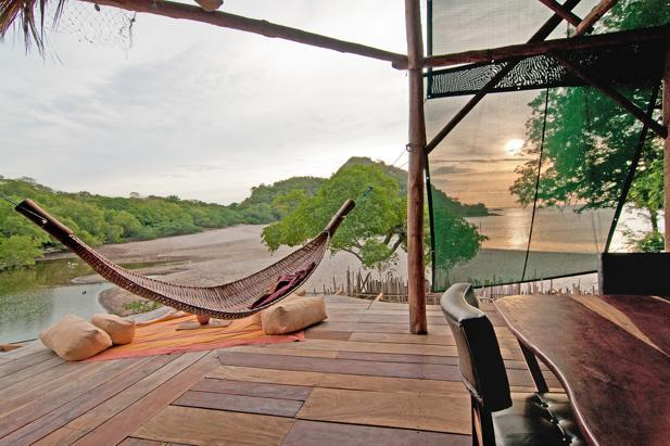 Hammock overlooking the ocean and estuary - A Beachfront Asian Style Treehouse - Playa Gigante - rentals