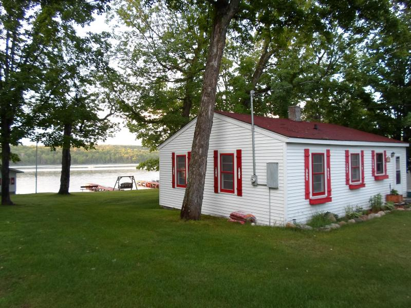 The cottage from the back, where parking is located. - A Cozy Lakefront Cottage, McPartlin's Resort Condo unit. (It is not a log cabin) - Land O  Lakes - rentals