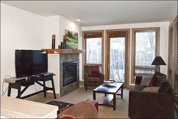Living Room Features a Flat-Screen TV, Gas Fireplace, and Sleeper Sofa - Remodeled Condo Overlooking Trail Creek - In the Two Bridges Complex (1231) - Ketchum - rentals