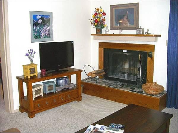 Living Room Includes a Wood-Burning Fireplace and Flat-Screen TV - Comfortable & Open Condo - Mountain Views (1258) - Crested Butte - rentals
