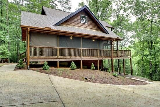 SERENITY NOW LODGE*2 BEDROOM/2 BATHROOM IN COOSAWATTEE RESORT~SLEEPS 6~SCREENED PORCHES~HOT TUB~GAS GRILL~FIRE PIT~PING PONG~FOOSEBALL~WIFI~ALL KINDS OF GAMES~$125/NIGHT - Image 1 - Blue Ridge - rentals