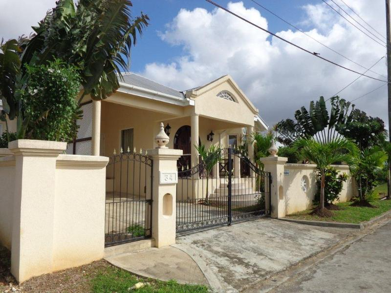 Beautiful Front View of property - The May Queen - Feel the Tropical Breeze - Maynards - rentals