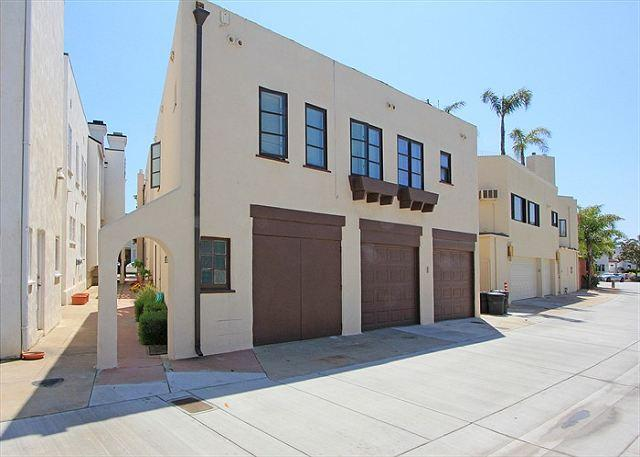 Enter the unit through the archway on the left. The door to the property is just to the right, with a dolphin door-knocker. - Classic Spanish-style apartment in lovely Peninsula Point neighborhood(68253) - Newport Beach - rentals