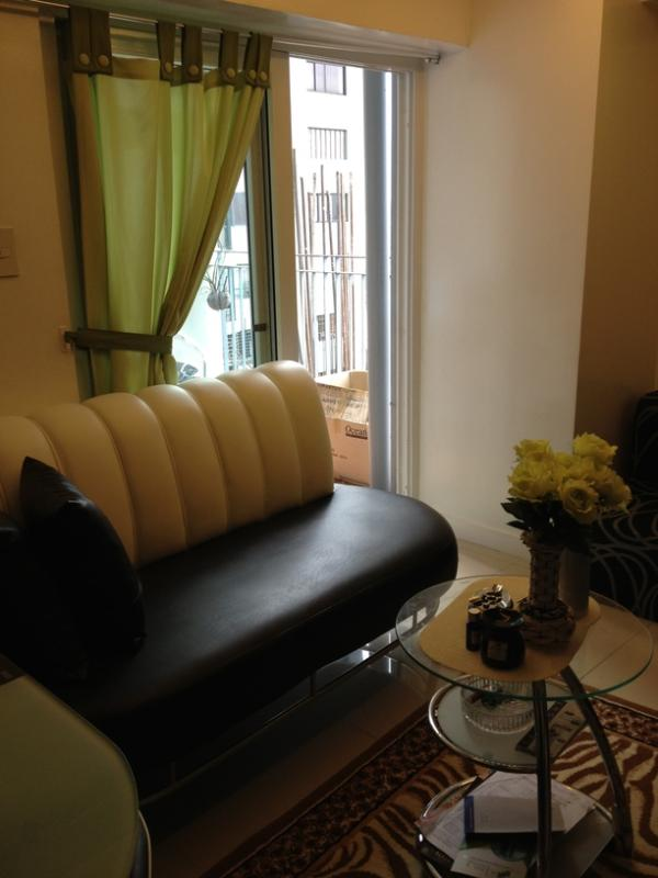 Sofa bed at the living room - Backpacker's delight 2BR Apartment Unit with AC - Quezon City - rentals