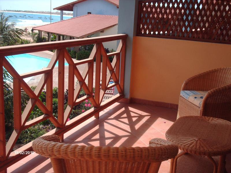 view from the balcony over the pool to the pier - Beach front 1 bedroom apartment Porto Antigo 2 the best frontline development in Santa Maria Sal Island Cape Verde - Santa Maria - rentals