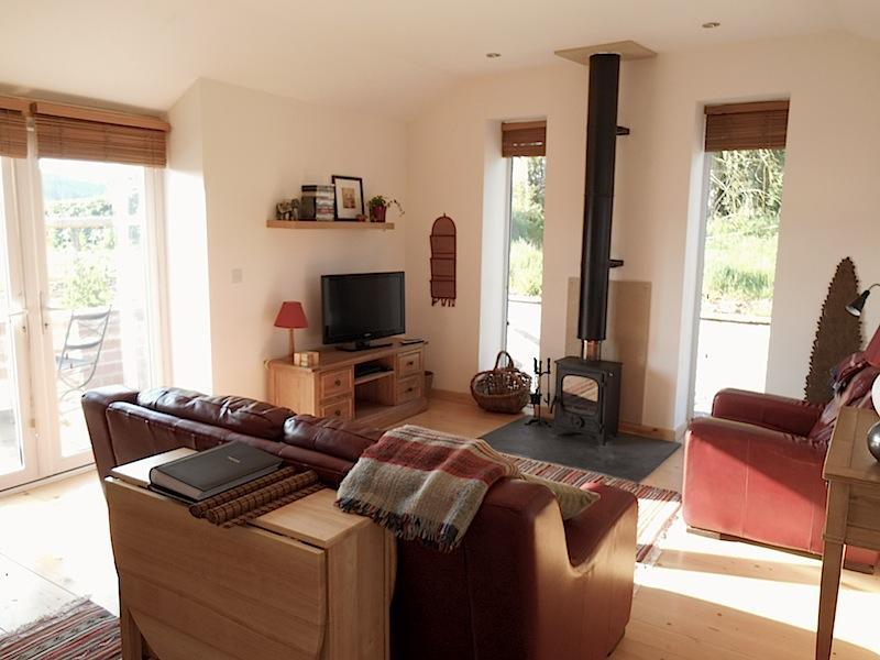 Living Area with wood-burnubing stove - Monmouthshire Holiday Barn with stunning views - Chepstow - rentals