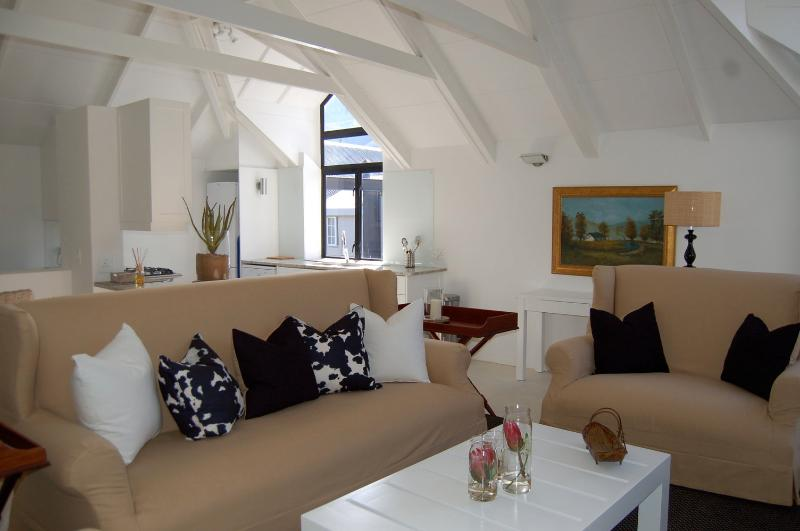 Lounge Area with fireplace - The Yard Apartments - No. 6 at The Yard - Franschhoek - rentals
