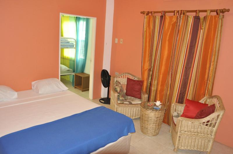 Bedroom with queen size bed - Fish Tobago Guesthouse - Lagoon Apartment - Buccoo - rentals