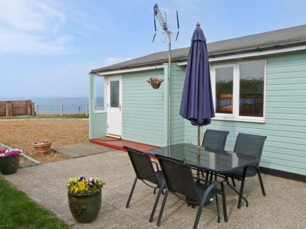 SEACLOSE detached beach front cottage, pet-friendly, sea views in Walcott Ref - Image 1 - Walcott - rentals