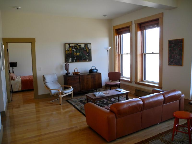 Living room area of the apartment with a view out to the Lamoille River. - Vacation Rental/Historic Building - Hardwick - rentals