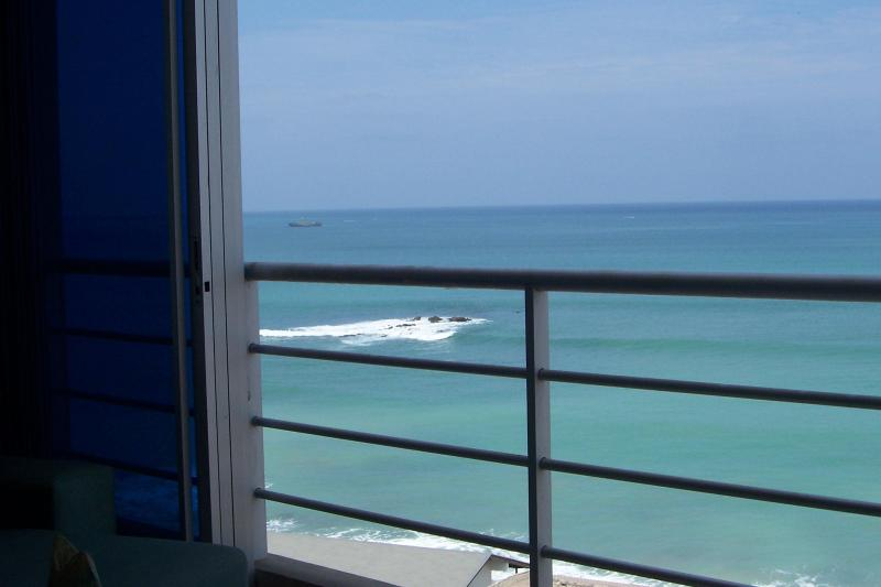 View from living room with sliding doors open - Beautiful Oceanfront Condo in Salinas Ecuador - Salinas - rentals