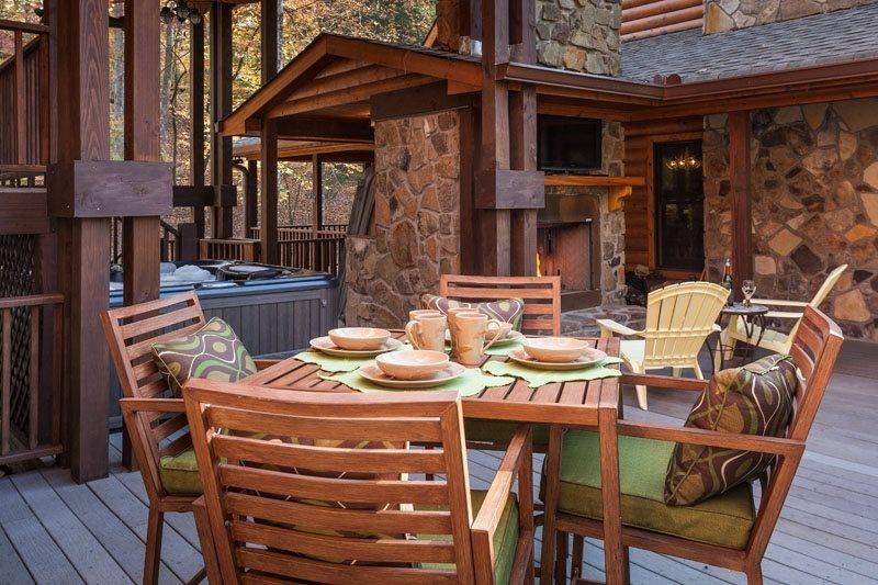 Seating on the deck with outdoor fireplace, grill and TV - 4 Bedroom Rental Cabin With Available Guest House - Ellijay - rentals