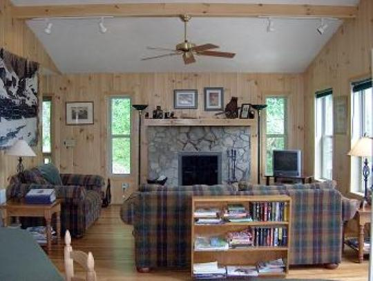 Living room w/stone wood burning fireplace - At River Glen-Private Cabin On River - West Jefferson - rentals