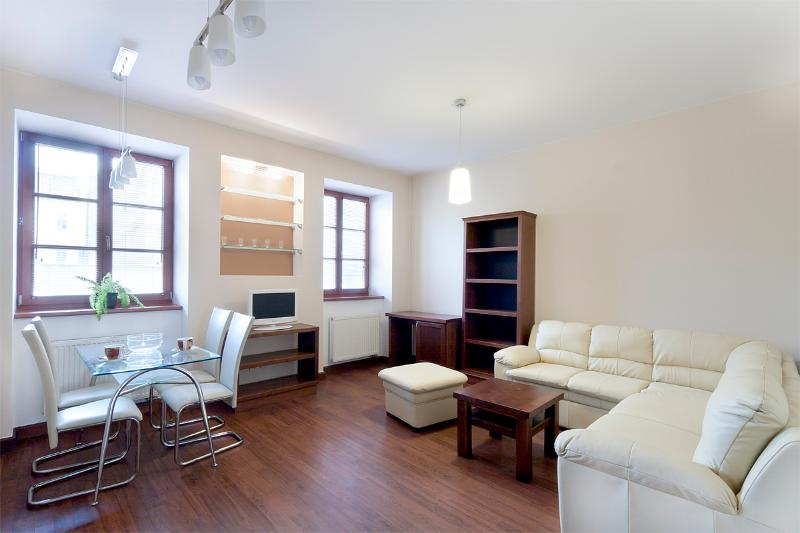 The living room area with kitchen. Fan available. - Affordable Air-con. Charming luxury Andel Ap. - Prague - rentals