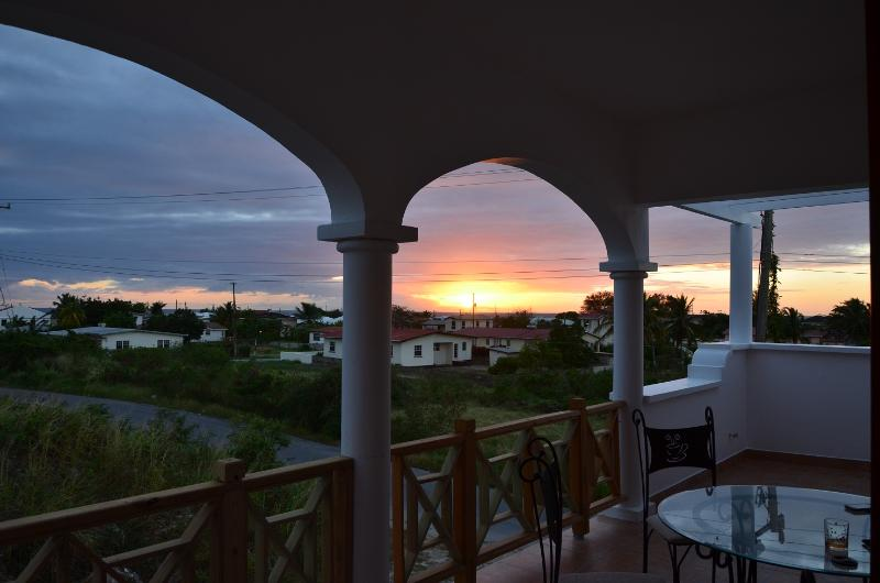 sunset view from 1st floor balcony - New condo with large balcony - Oistins - rentals