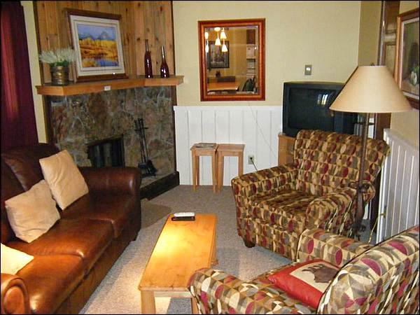 Cozy Living Room has a Fireplace and Sleeper Sofa - Cute Base Area Condo - Private Balcony with Mountain Views (1353) - Crested Butte - rentals