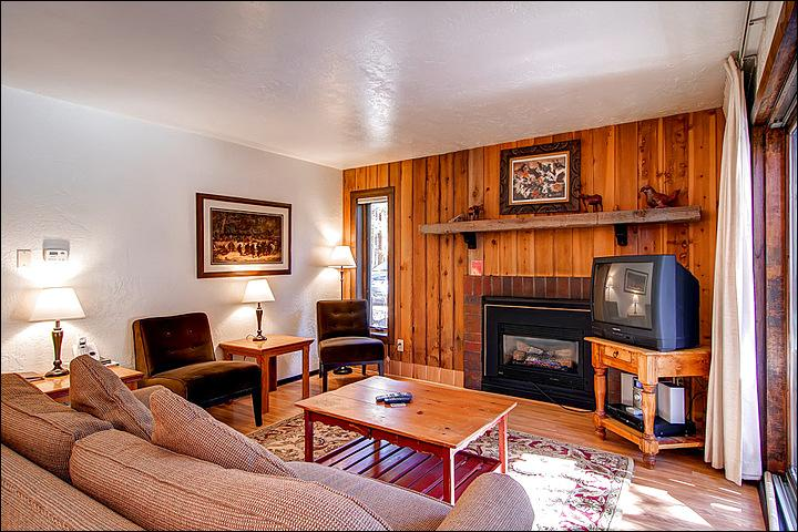 TV and Fireplace in the Living Room - Cute, Ground Level Condo - Completely Remodeled Kitchen (13147) - Breckenridge - rentals