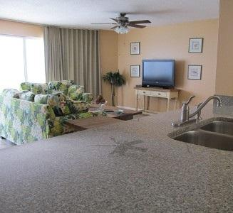 The kitchen is open to the living room and has Gulf views - Long Beach Resort 2-1203 - Panama City Beach - rentals