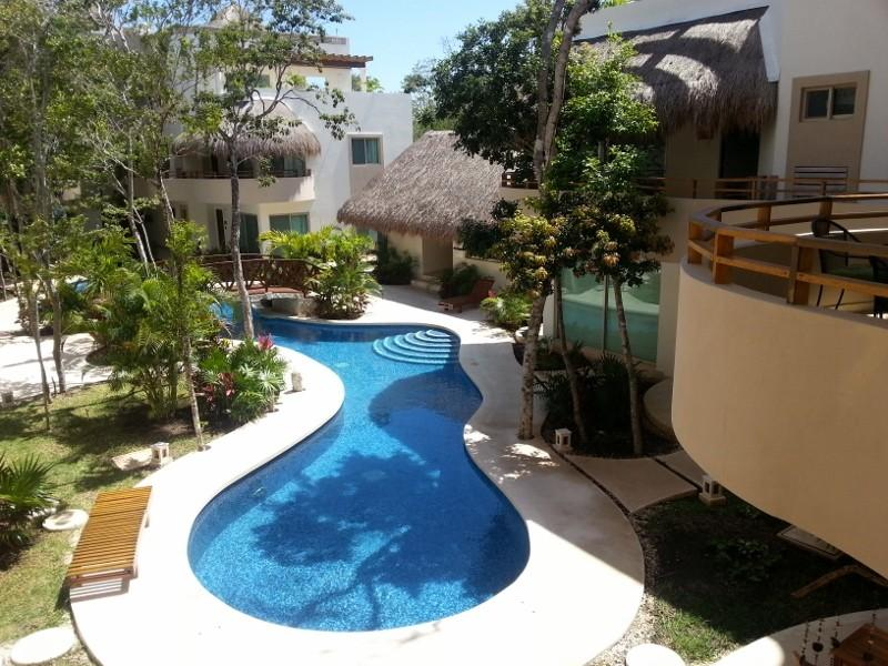 This is the view of the pool and garden area from the front entrance and balcony of Mariposa Azul. - Easter available in gorgeous Mariposa Azul  2 bed in Tulum - Minutes to Beaches - Tulum - rentals