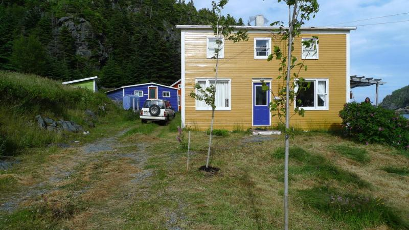Main Cottage deck and harbour to the right - EAST COAST NEWFOUNDLAND COTTAGE BY THE SEA - Tors Cove - rentals