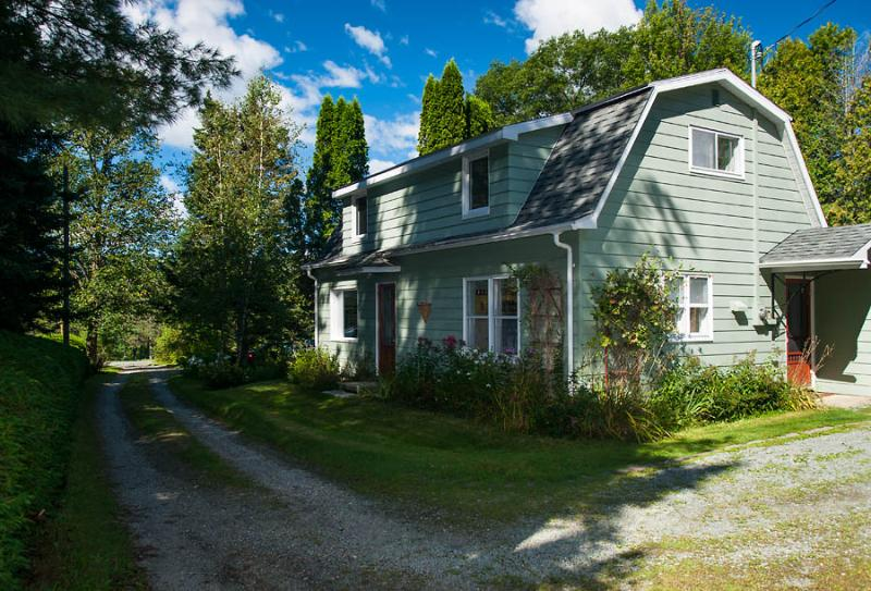 Front exterior with long private lane leading to Massawippi Rd, entrance via side door - Rustic Country House close to the lake - North Hatley - rentals