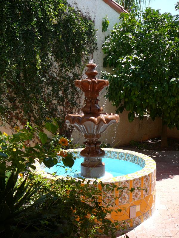 Entry courtyard - fountain designed of tiered stone and colorful Talavera Grapefruit & naval orange - Modern Mexican casita on Oro Valley golf course - Oro Valley - rentals