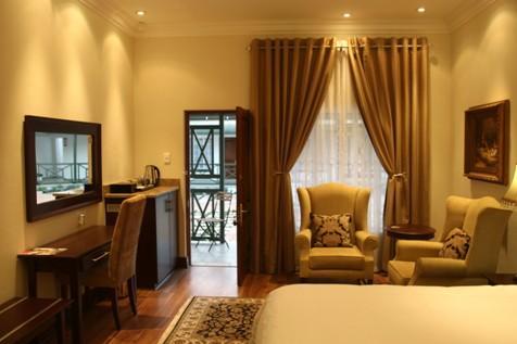 Room lighting and view standing from bathroom door. - Ann Villa Guest House - Klerksdorp - rentals