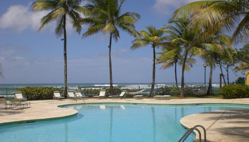 swimming pool overlooking beautiful beach - RESORT STYLE BEACH VILLA DORADO REEF, PUERTO RICO - Dorado - rentals