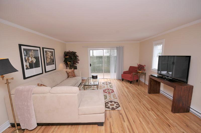 Living Room with Sectional Sofa and 50