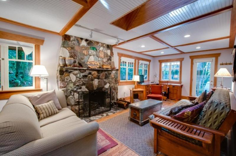 Cozy dog-friendly riverfront cottage w/ charming interior & hot tub! - Image 1 - United States - rentals