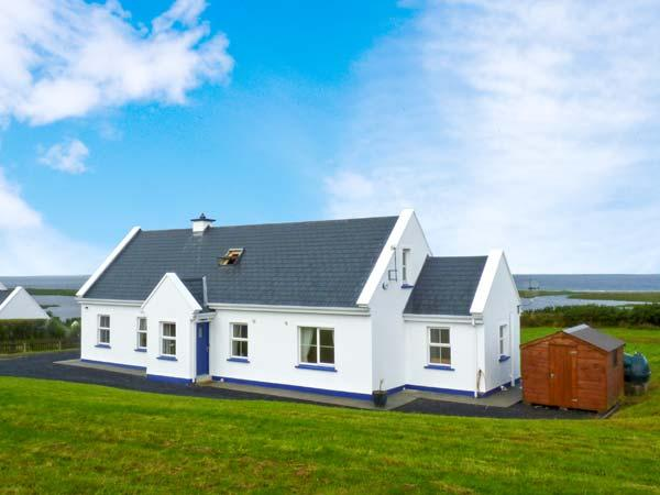 CROSS WINDS, detached cottage, open fire, enclosed gardens, sea views, near Louisburgh, Ref 27351 - Image 1 - Louisburgh - rentals