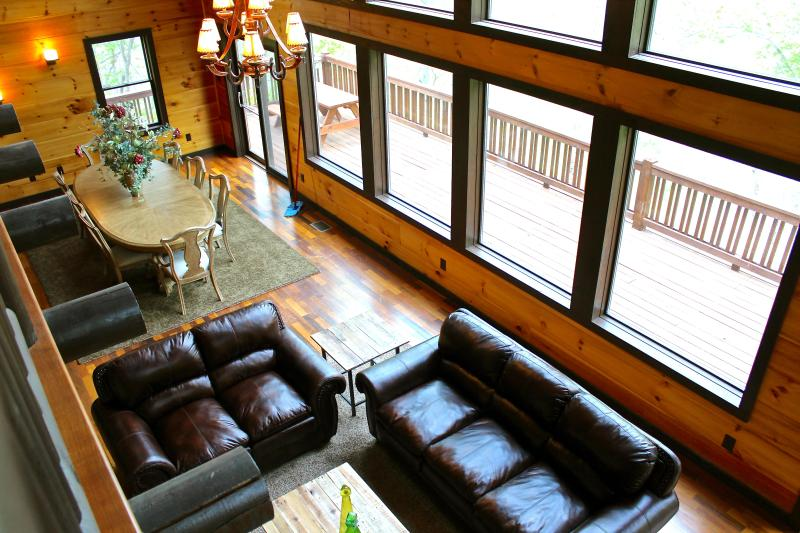 Living area, leather furnishing, lots of windows - Elk River cabin sits on 40 acres and big river to explore. Mtn Views. Gorgeous! - Butler - rentals