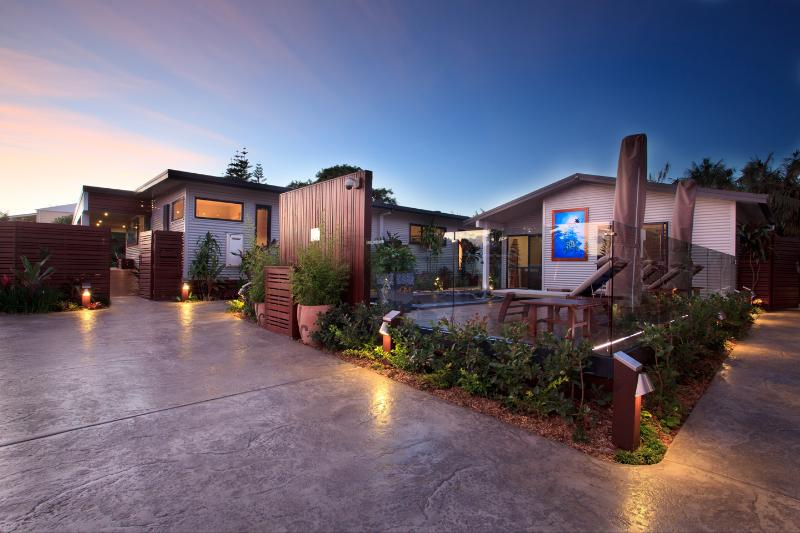 Outdoor courtyard at dusk - The Tin Sheds - Island Luxury 5 Star Apartment - Norfolk Island - rentals